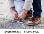 dad tying the laces on a child... | Shutterstock . vector #643915933