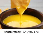 Dipping Chips Into Bowl With...