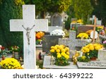 cemetery cross and flowers on the All Saints Day, Wroclaw, Poland - stock photo