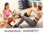 young women doing sit ups in a... | Shutterstock . vector #644048797