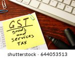 notepad with word gst goods and ... | Shutterstock . vector #644053513