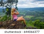 a beautiful girl in a dress is... | Shutterstock . vector #644066377
