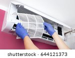 air conditioner cleaning. man... | Shutterstock . vector #644121373
