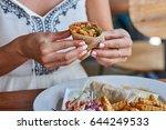 female hands holding tasty... | Shutterstock . vector #644249533