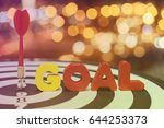 Small photo of Red dart target arrow hitting on bullseye with goal words over bokeh light background vintage tone,metaphor to accuracy in business success concept
