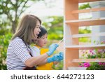 asian mother and son painting... | Shutterstock . vector #644272123