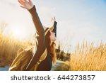 beautiful girl in a wheat field ...   Shutterstock . vector #644273857