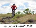 cyclist in red jacket riding... | Shutterstock . vector #644317567