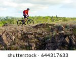 cyclist in red jacket riding... | Shutterstock . vector #644317633