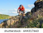 cyclist in red jacket riding... | Shutterstock . vector #644317663