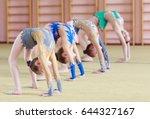 young girls doing gymnastics. | Shutterstock . vector #644327167
