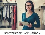 beautiful female shop assistant ... | Shutterstock . vector #644350657