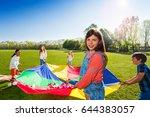 girl holding rainbow parachute...   Shutterstock . vector #644383057