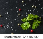 green fresh parsley on black... | Shutterstock . vector #644402737