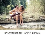 couple of lovers playing guitar ... | Shutterstock . vector #644415433