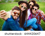group of friends enjoying party.... | Shutterstock . vector #644420647