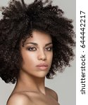 Small photo of Beauty photo of natural young african american girl with afro hairstyle.