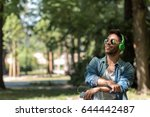young man listening to music on ... | Shutterstock . vector #644442487