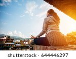 a hipster woman doing yoga pose ... | Shutterstock . vector #644446297