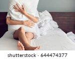 sad woman hugging a pillow... | Shutterstock . vector #644474377