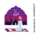 ramadan kareem. muslim man... | Shutterstock .eps vector #644489617