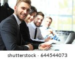 business people sitting in a... | Shutterstock . vector #644544073