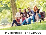 group of young people having... | Shutterstock . vector #644629903