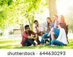 group of young people having... | Shutterstock . vector #644630293