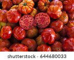 two halves of juicy ripe tomato ... | Shutterstock . vector #644680033