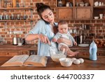 young mother holding her son ... | Shutterstock . vector #644700337