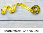 roll of yellow measuring tape... | Shutterstock . vector #644739223