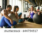 group of people workout in... | Shutterstock . vector #644754517