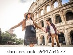 young couple at the colosseum ... | Shutterstock . vector #644754577
