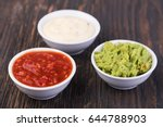 bowls with sauces on white... | Shutterstock . vector #644788903