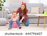 little girl and her mother... | Shutterstock . vector #644796607
