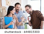 cheerful woman is holding blue... | Shutterstock . vector #644815303