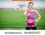 asia woman athlete listing to... | Shutterstock . vector #644852947