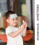 asian boy having fever . the... | Shutterstock . vector #644870083
