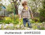 cute little boy watering plants ... | Shutterstock . vector #644932033