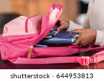 schoolgirl packing backpack and ... | Shutterstock . vector #644953813