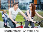 young parents ride a bicycle... | Shutterstock . vector #644981473