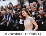 olga kurylenko attends the 'the ... | Shutterstock . vector #644985763