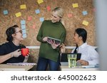 women are working together in... | Shutterstock . vector #645002623