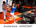 personal trainer assisting... | Shutterstock . vector #645025687