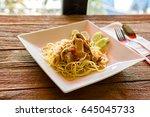 spaghetti pasta with pork and... | Shutterstock . vector #645045733