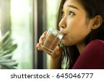 young girl drinking water. | Shutterstock . vector #645046777