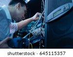 handsome young engineer fixing... | Shutterstock . vector #645115357