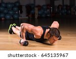 young man athlete doing pushups ... | Shutterstock . vector #645135967