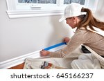 woman painting wall | Shutterstock . vector #645166237