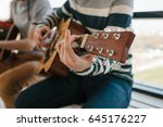 learning to play the guitar.... | Shutterstock . vector #645176227